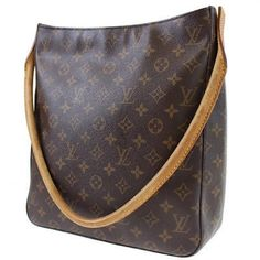 """Louis Vuitton Looping GM Louis Vuitton Looping GM. Classic monogram canvas, brass hardware, warm honey patina leather accents. Zipper works perfectly. Made in France. Very large in size. Can carry many of your daily essentails. One interior pocket. Great for any event. L 12.3 x H 11 x D 5"""".  Date code 0U0071. Minor wear & dirt on interior. Minor wear on handle. Please see images posted. Louis Vuitton Bags Shoulder Bags"""
