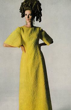 Wilhelmina is wearing a bright yellow dress with cloque sleeves by Stella, photo by Penn for Vogue 1965
