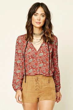 Forever 21 Contemporary - A woven top featuring a ruffled contrast self-tie split neckline, long buttoned sleeves, and an allover ornate paisley pattern.