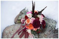 Beautiful Bridal Bouquet winter marsala orange red pink by Design Resource. Spruce Mountain Ranch, Larkspur, CO
