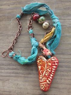 Mixed Media Polymer Clay Rustic Boho Gypsy Abstract Heart Tribal Doodle Pattern on Sari Silk Ribbon and Chain with Ceramic Beads by SpontaneousSoul on Etsy https://www.etsy.com/listing/216484806/mixed-media-polymer-clay-rustic-boho