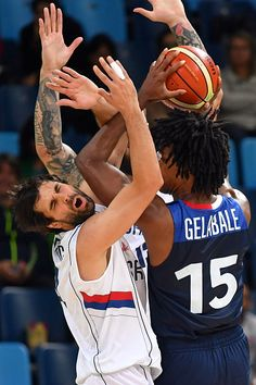 #RIO2016 Serbia's guard Milos Teodosic collides with France's small forward Mickael Gelabale during a Men's round Group A basketball match between Serbia and...