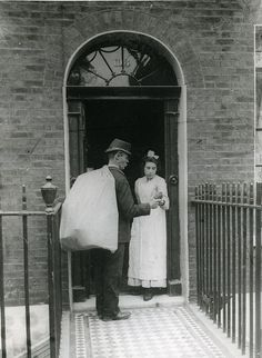Postman delivering parcel c1905