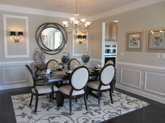 This Unusual Mirror Features A Frame Made Of Three Entwined Circles With Matte Black Finish Dining Room