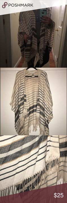 BCBG poncho NEVER WORN. Hooded poncho. Cozy! Free size. NWOT. Beautiful pale pink poncho. BCBGeneration Sweaters