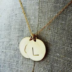 Hey, I found this really awesome Etsy listing at http://www.etsy.com/listing/101515912/two-letter-gold-initial-necklace-charms