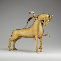 Aquamanile in the Form of a Horse Date: ca. 1400 Geography: Made in Nuremberg Culture: German Medium: Copper alloy Dimensions: Overall: 13 1/4 x 14 1/2 x 3 3/4 in. (33.7 x 36.8 x 9.5 cm) Overall PD: 13 1/4 x 3 3/4 x 15 in. (33.6 x 9.5 x 38.1 cm) Thickness PD: 2/25 in. (0.2 cm) Classification: Metalwork-Copper alloy Credit Line: Gift of William M. Laffan, 1910 Accession Number: 10.13.4a - Add MetMuseum on Pinterest at http://www.pinterest.com/metmuseum/