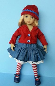 Little Darling Doll wearing ruffled denim skirt, candy cane stripe tights and soft furry jacket and hat. Trimmed with broderie anglaise lace and ric-rac.