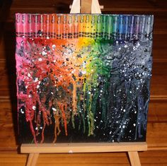 flat canvas board painted black makes the melted crayons stand out!!!