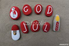 "Download the royalty-free photo ""God Jul, Happy New Year in swedish language on colored stones"" created by Ciaobucarest at the lowest price on Fotolia.com. Browse our cheap image bank online to find the perfect stock photo for your marketing projects!"