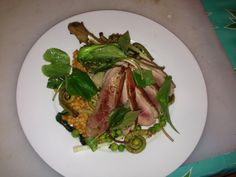 Spring Duck, with fiddleheads, ramps, English peas and red pepper Israeli couscous - all from Weinhard Cafe in Dayton!