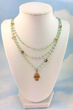 Hey, I found this really awesome Etsy listing at https://www.etsy.com/listing/184769583/gold-hamsa-necklace-aqua-chalcedony
