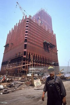 A construction worker walks past the emerging structure of the Twin Towers on the World Trade Center site in downtown New York, circa 1970.