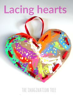 Make some beautiful cardboard lacing hearts for a Valentine's day craft for kids to try.