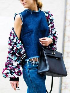Frayed denim and an embellished bomber jacket. Streetstyle inspiration. Denim on denim with a touch of colour.