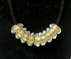 Fashion black and gold sparkly necklace by Lucine