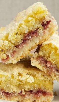 Coconut Raspberry Bars ~ an almond shortbread crust, lovely raspberry preserves, and a chewy topping filled with lots and lots of coconut.