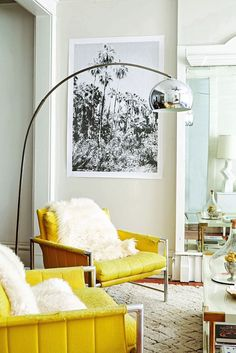 Yellow chair, accent colour, silver lamp, lovely living area!