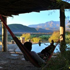 Recharge your batteries at the wonderful, off-the-grid Numbi Valley, De Rust Permaculture Farm. Nothing like chilling in a hammock while gazing at the beautiful mountains!   #recharge #hammock #relax #southafrica #mountains