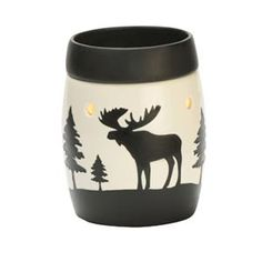 Yukon Full-Size Scentsy Warmer PREMIUM - Cast in porcelain, Yukon glows from within, diffusing light reminiscent of a cabin-style rawhide lampshade. Its hand-painted rustic design features tall evergreens and a stately moose silhouette.
