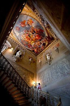 The Great Staircase with the allegorical ceiling looking particularly bright. Wrought iron railings by Jean Yijou a French Huguenot brought to England by Sir Christopher Wren for the rebuilding of St Paul Cathedral ..... After the Great Fire of London