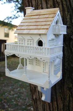 "Seaside Cottage: this birdhouse has a combination of ""Victorian"" and ""Cottage"" styling! This 2-story birdhouse has 2 separate nest boxes, one up and one downstairs."