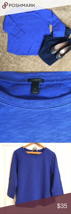 NWOT Jcrew sweatshirt NWOT beautiful blue sweatshirt that is not too thick and not too thin. A slightly longer 3/4 sleeve, making it perfect for fall or layering. Perfect condition. J. Crew Tops Sweatshirts & Hoodies