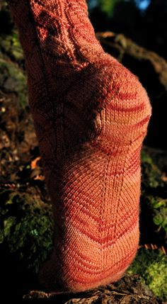 Pyroclastic sock - Knitty: Winter 2009 Top down with Elizabeth Zimmerman inspired shaped arch.