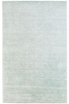 Infuse your favorite spaces with elegant design and delightful texture with this loom-knotted carpet. Its light blue-green hue and subtle sheen make it an eye-catching centerpiece, while its ultrasoft bamboo silk and cotton construction make it perfect for the master bedroom, living room, or dining room.