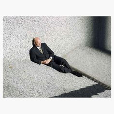 This photograph was taken in #Chicago at midday John MacLean (@john_maclean_photo) writes Im still a little unsure why such a well-dressed man would be slumped against a wall in this manner but I love the mystery and paradox in this image. In a large print its easy to see the time of day on his watch his manicured hands the freckles on his head and the sun glinting off his glasses. The shadows are perfect too they are one of photographys unpredictable gifts in this case. Follow…