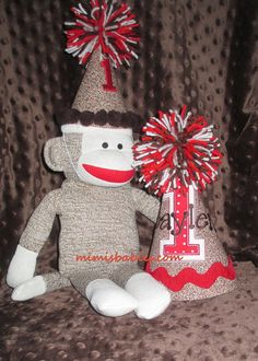 Sock Monkey with a custom birthday hat! You can have a custom hat made for your birthday child and then get a sock monkey with a matching custom hat : )