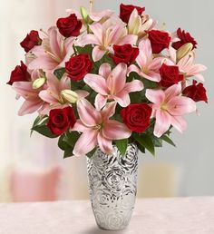 Romantic Rose and Lily Bouquet One dozen long-stem red roses, a traditional symbol of love and passion, are elegantly paired with soft pink Asiatic lilies in this truly original romantic display. Beautiful Bouquet Of Flowers, Beautiful Flower Arrangements, All Flowers, Floral Arrangements, Rose And Lily Bouquet, Rose Lily, Flowers For Valentines Day, Send Roses, Dozen Red Roses