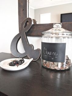 paint a chalkboard onto a large glass jar. Use it for change and it's decorative
