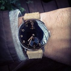 RADIUMACTIVE! Cooooool this beautiful 1940s Omega w/radium hands, radium dial, and black over-sized face. SO F'ING COOL