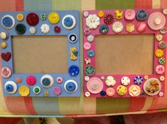 BUTTON FRAME-This pair of children's frames were done for a set of fraternal twins therefore, one blue & one pink, da......I was able to find some precious antique and Art Deco  baby buttons in various animal & toy shapes. I also hand painted and stacked some buttons for embellishment.