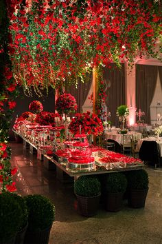 Beautiful red centerpieces and hanging florals - perfect for a chic and dramatic wedding or a Christmas or Valentine's Day wedding
