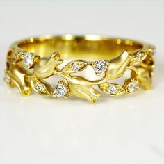 Tulip ring from #parade Designs in yellow gold with diamonds *** I already own a version of this ring with a center stone (blue zircon) and it is my favorite ring after my wedding ring.