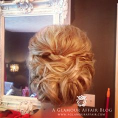 bridal updo, low bun, wedding hair, updo, formal updo This was at our studio.