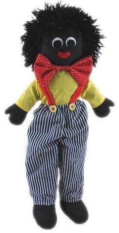 Louis  Blue and white striped pants with red suspenders with yellow buttons. A big red and white spotted bow  tie makes him very dapper. 30cm high.