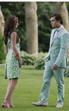 """""""'Just three little words. All you have to do is say them...' For this poignant Chair moment I wanted their costumes to be directly connected and seem like they were part of a fairy-tale garden,"""" Daman reveals. """"The soft green of Chuck's Boss suit and the abstract leaf print on B's Milly dress melt beautifully into the moors of this Hampton estate. I wanted it to feel they would never leave and always be in this heavenly color-coated atmosphere"""""""
