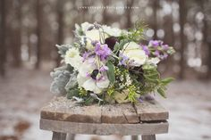 Brocade Designs Blog - winter styled shoot with Elizabeth of Stockroom Vintage @Elizabeth Ulrich and photographer Jenny Cruger - A magical table set in the woods with blooms in brass vessels. The bouquet was a perfectly untamed mix of anemone, dusty miller, lavender, scabiosa, stock and rannunculus.