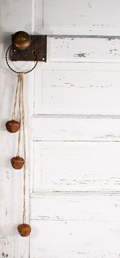 NAC, do this with the shiny bells and an old bangle bracelet...Primitive Rusty Jingle Bell Door Knob Hanger - Rusty Tin Bells - Rusty Tin Primitives - Primitive Decor