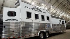 Triple C Trailers to exhibit at Stetson Country Christmas in Las Vegas. Custom Bloomer Horse Trailer interior living quarters trailer.