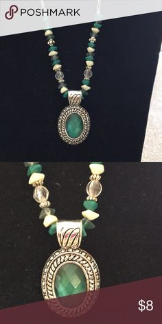 Avon necklace Very springy necklace in silver, green and cream colors. Very pretty and excellent condition! Jewelry Necklaces