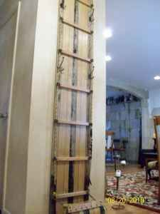 Vintage Toboggan Sled has been repurposed into a clever coat rack or entry hall tree
