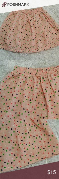 Tiny Hearts Skirt.  Kids. Adorable peach color skirt with tiny Hearts all over. Pull up style  This item is brand new and never used. No tags Bottoms Skirts