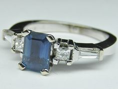 Emerald Cut Blue Sapphire and Diamond Engagement Ring, might be better with diamond in the middle and one saphire on each side