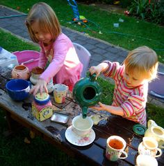 get a real ceramic tea set & accessories from a  thrift store & have a water & mud & glitter tea party!