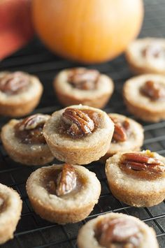Mini Pecan Pumpkin Pies dessert recipe is all that is wonderful about the holidays rolled into one bite size treat that combines pumpkin and pecan pie!