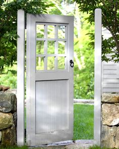 Door Garden gate. Carefully painted a creamy white with a stone wall makes the garden door-gate more traditional rather than rustic. Would be the perfect accent to the cottage garden.